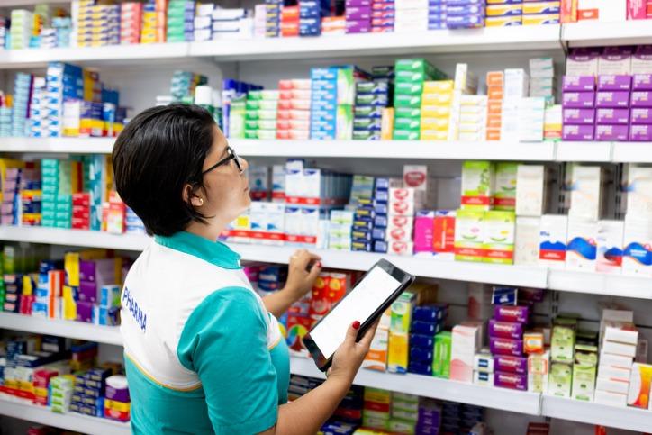 How do pharmacies account for VAT?